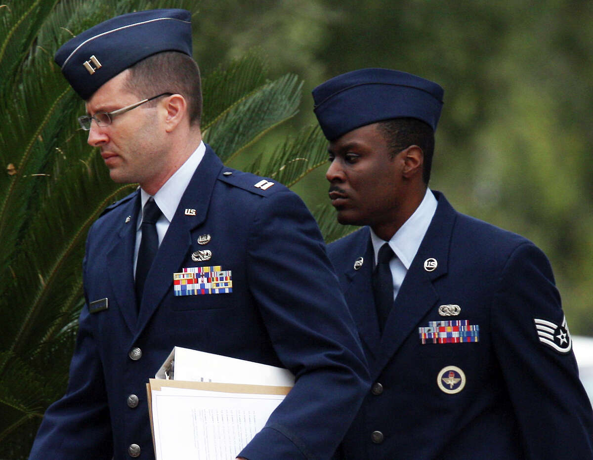 U.S. Air Force 321st Training Squadron Staff Sgt. Donald Davis, right, arrives for a hearing at Lackland Air Force Base, Thursday, Nov. 15, 2012. Davis is facing charges of aggravated sexual contact, assault and battery on one female trainee.