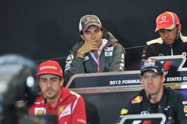 Mexican Sergio Perez (upper left) listens to questions during a Thursday press conference at the Circuit of the America's. He is surrounded by Lewis Hamilton (upper right)), Sebastian Vettel (lower right), and Fernando Alonso (lower left). Photo: Robin Jerstad/For The Express-Ne