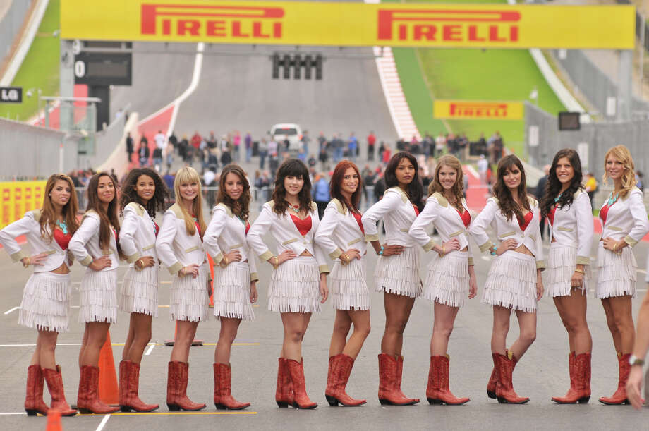 Formula 1 Grid Girls dressed in a Texas motif pose for pictures along the main straight of the Circuit of the America's Thursday morning near Austin. Photo: Robin Jerstad/For The Express-Ne