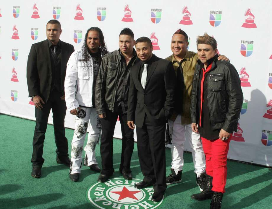 Music group Siggno arrives for the 13th Annual Latin Grammy Awards on November 15, 2012 in Las Vegas, Nevada.    AFP PHOTO/John GURZINSKIJOHN GURZINSKI/AFP/Getty Images Photo: JOHN GURZINSKI, Getty Images / AFP