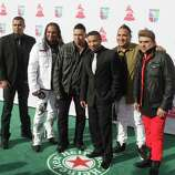 Music group Siggno arrives for the 13th Annual Latin Grammy Awards on November 15, 2012 in Las Vegas, Nevada.    AFP PHOTO/John GURZINSKIJOHN GURZINSKI/AFP/Getty Images