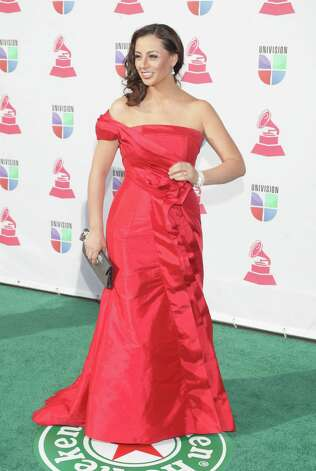 Ecuadoran singer Paulina Aguirre arrives for the 13th Annual Latin Grammy Awards on November 15, 2012 in Las Vegas, Nevada.    AFP PHOTO/John GURZINSKIJOHN GURZINSKI/AFP/Getty Images Photo: JOHN GURZINSKI, Getty Images / AFP