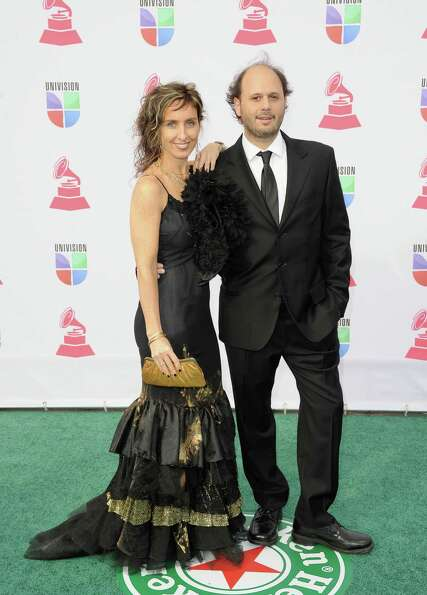 (L-R) Artist Vicky Barranguet and musician Gustavo Casenave arrive at the 13th annual Latin GRAMMY A