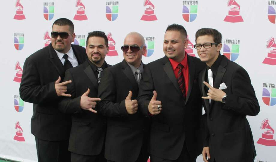 Grupo Destino arrives for the 13th Annual Latin Grammy Awards on November 15, 2012 in Las Vegas, Nevada.    AFP PHOTO/John GURZINSKIJOHN GURZINSKI/AFP/Getty Images Photo: JOHN GURZINSKI, Getty Images / AFP