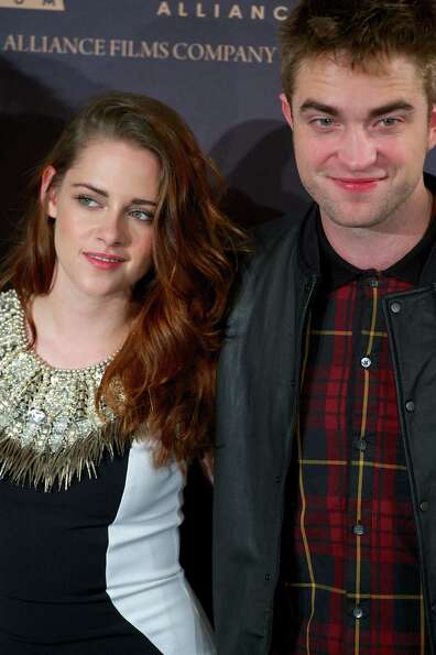 MADRID, SPAIN - NOVEMBER 15:  Actress Kristen Stewart and actor Robert Pattinson attend the