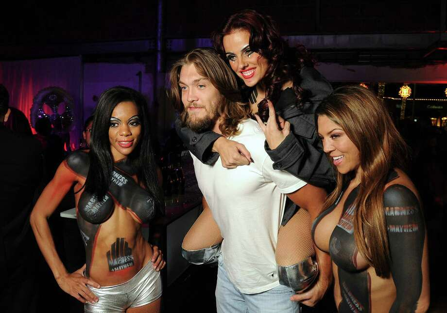 Houston Texan Bryan Braman poses with fans at the Fashion Houston afterparty in the old Tootsie's space in Highland Village on Nov. 14. The party was sponsored by the Houston Chronicle's new Style section.  Photo: Dave Rossman, For The Houston Chronicle / © 2012 Dave Rossman