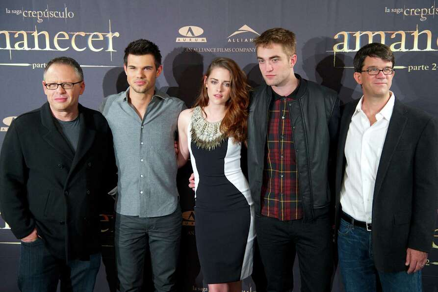 MADRID, SPAIN - NOVEMBER 15:  (L-R) Director Bill Condon, actors Taylor Lautner, Kristen Stewart, Ro
