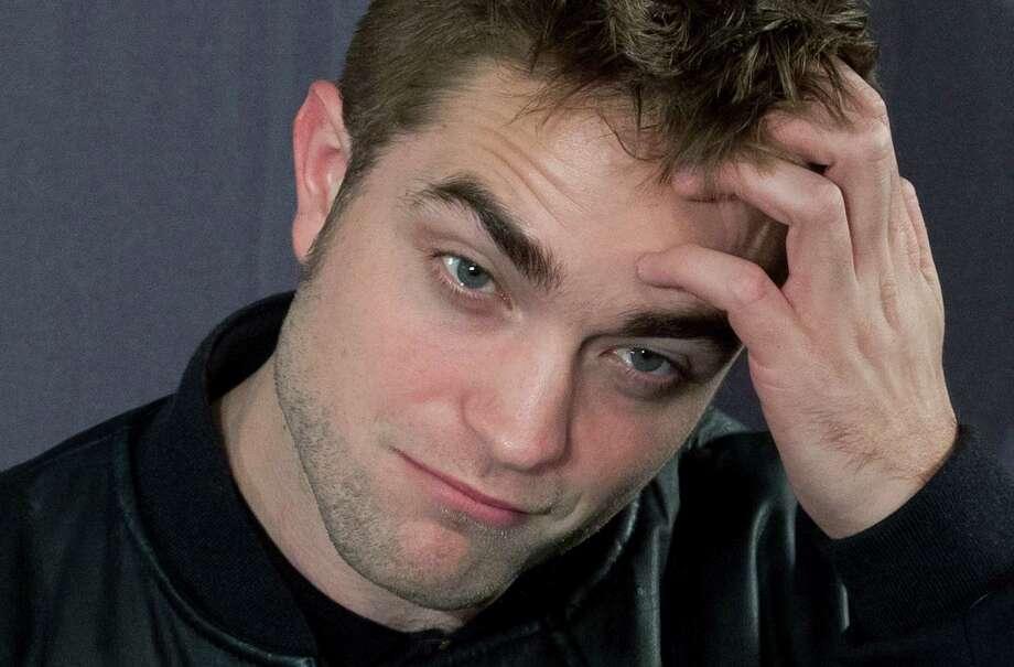 "British actor Robert Pattinson poses during a photo call for the film ""The Twilight Saga: Breaking Dawn-Part 2""  in Madrid, Spain, Thursday, Nov. 15, 2012. ( AP Photo/Gabriel Pecot) Photo: Gabriel Pecot, Associated Press / AP"