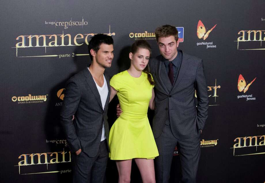"American actor Taylor Lautner, left American actress Kristen Stewart, center and British actor Robert Pattinson pose during a photo call at the Spanish premiere of the film ""The Twilight Saga: Breaking Dawn-Part 2"" in Kinepolis Cinema in Madrid, Spain, Thursday, Nov. 15, 2012. ( AP Photo/Gabriel Pecot) Photo: Gabriel Pecot, Associated Press / AP"