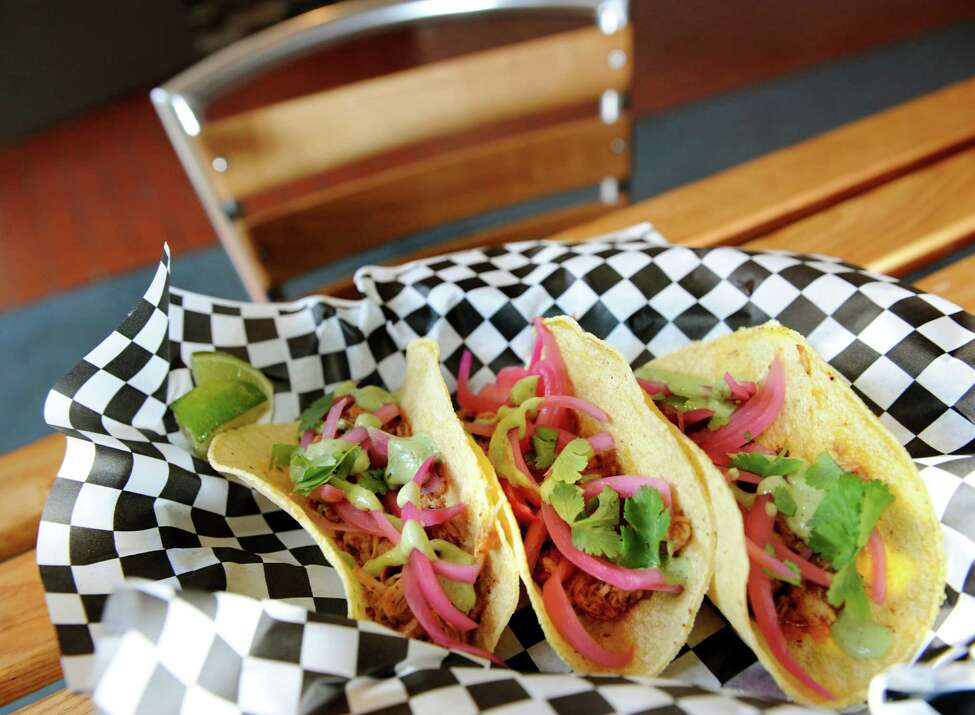 Tacos with chipotle chicken, pickled red onion and cilantro topped with avocado crema served inside corn tortillas on Saturday, Nov. 10, 2012, at the Comfort Kitchen in Saratoga Springs, N.Y. (Cindy Schultz / Times Union)