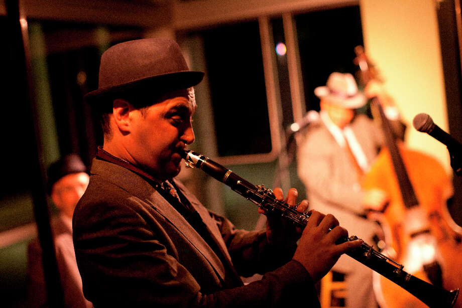 Jason Bellenkes of the Tom Martin Trio plays clarinet. Photo: Jason Henry, Special To The Chronicle / ONLINE_YES