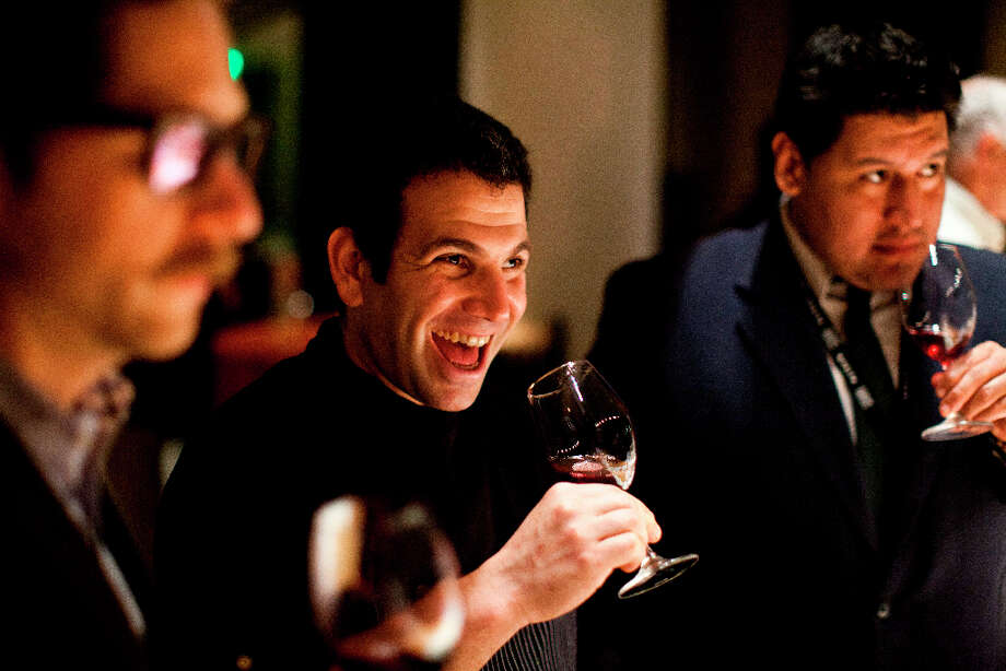 Ezra Duker, executive sous chef at Morimoto Napa, tastes wines from Ceja. Photo: Jason Henry, Special To The Chronicle / ONLINE_YES