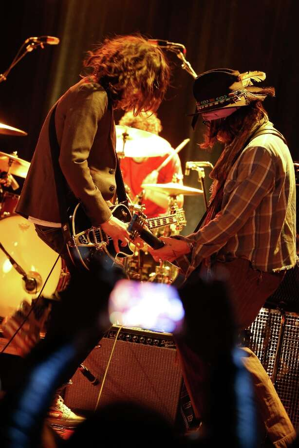 Musician Nick Valensi of The Strokes (L) and actor Johnny Depp perform onstage during the first ever Jameson Petty Fest West at El Rey Theatre on November 14, 2012 in Los Angeles, California.  (Photo by Imeh Akpanudosen/Getty Images For Jameson) Photo: Imeh Akpanudosen, Getty Images For Jameson / 2012 Getty Images
