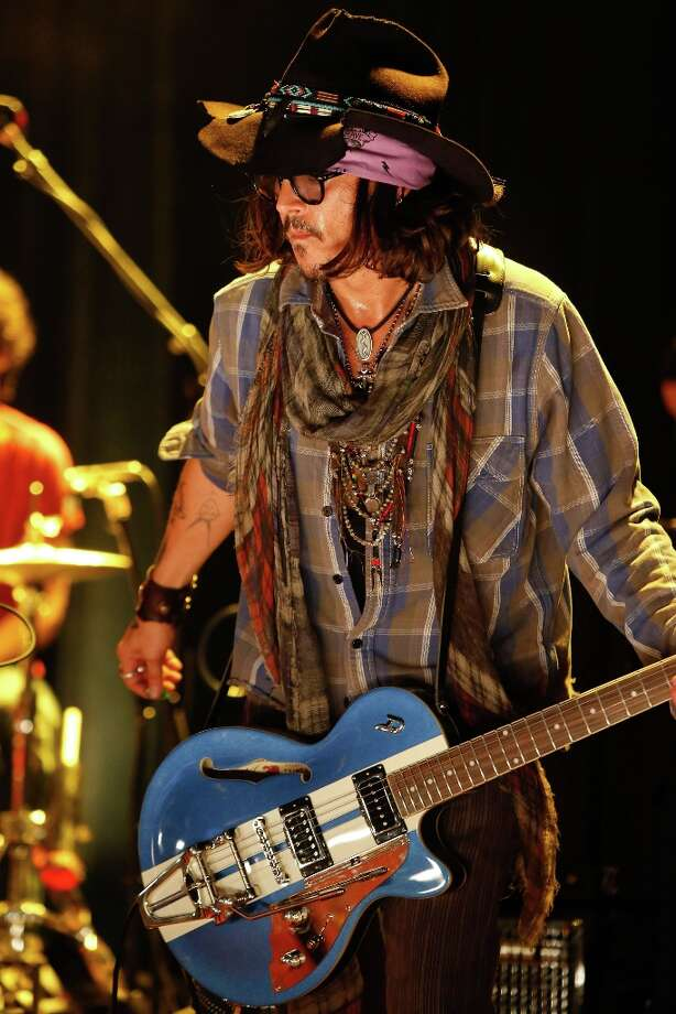 Actor Johnny Depp performs as a guest guitarist onstage during the first ever Jameson Petty Fest West at El Rey Theatre on November 14, 2012 in Los Angeles, California.  (Photo by Imeh Akpanudosen/Getty Images For Jameson) Photo: Imeh Akpanudosen, Getty Images For Jameson / 2012 Getty Images