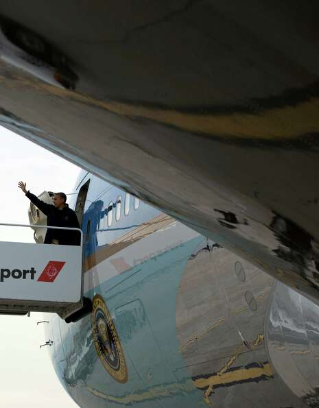 President Barack Obama waves as he boards Air Force One at John F. Kennedy International Airport, Th