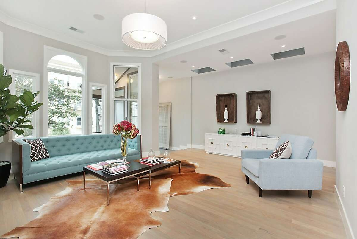 White oak hardwood flooring is featured throughout the home's main level, complemented by a pitch of gray that provides a neutral tone while creating warmth.