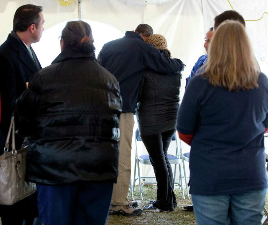 President Barack Obama comforts a woman at the FEMA recovery center on the grounds of New Dorp High School, Thursday, Nov. 15, 2012, on Staten Island, in New York. Photo: Carolyn Kaster, AP / AP