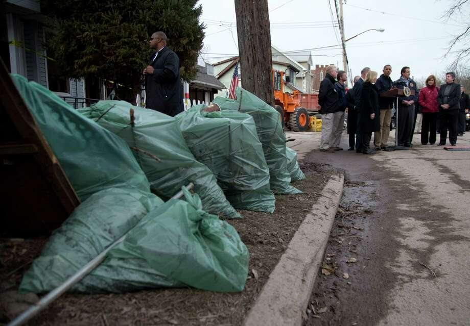 President Barack Obama talks to press on Cedar Grove Avenue, a street significantly impacted by Superstorm Sandy, Thursday, Nov. 15, 2012, on Staten Island, in New York. Photo: Carolyn Kaster, AP / AP