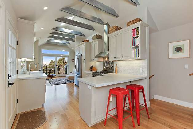 Providing an open and spacious feel, natural light pours into the kitchen from skylights in the vaulted ceiling of this two-level Queen Anne Victorian at 316 Rutledge St., Bernal Heights. The property sold for $1,530,000. Photo: OpenHomesPhotography.com