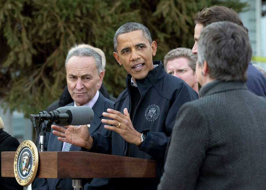 President Barack Obama gestures as he speaks during a news conference on Cedar Grove Avenue, a street significantly impacted by Superstorm Sandy, Thursday, Nov. 15,2012, on Staten Island, in New York. From left are, Sen. Charles Schumer, D-N.Y., the president, Housing and Urban Development Secretary Shaun Donovan, New York Gov. Andrew Cuomo and Homeland Security Secretary Janet Napolitano. Photo: Carolyn Kaster, AP / AP