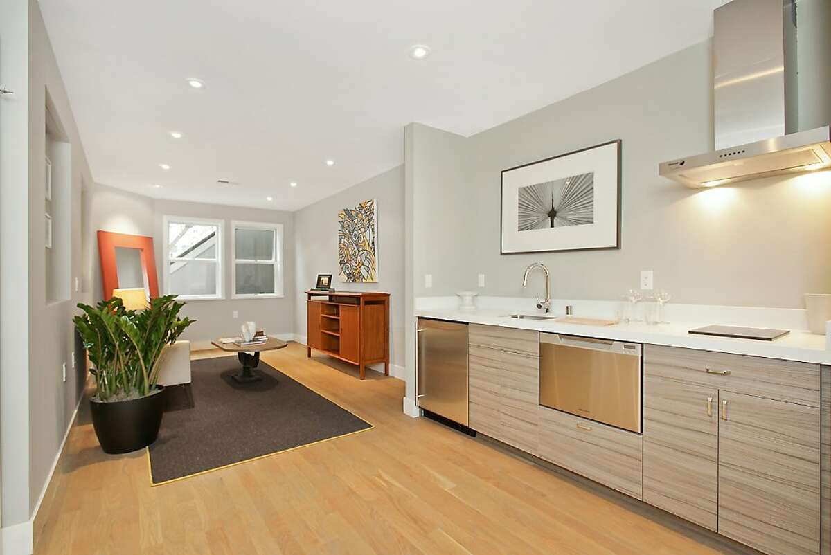 The home's flexible floor plan features a lower-level unit with a private entrance that is able to serve as a separate studio or an au pair space.
