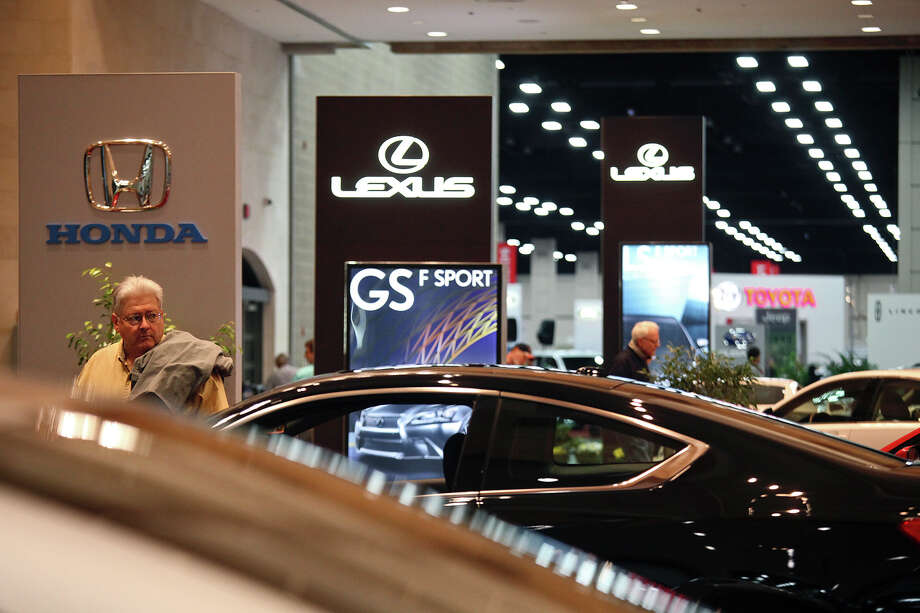 Thomas Hannibal, of Fair Oaks Ranch, looks at the Honda display as he makes his way around the San Antonio Auto and Truck Show at the Henry B. Gonzalez Convention Center on Thursday, Nov. 15, 2012. Photo: Lisa Krantz, San Antonio Express-News / © 2012 San Antonio Express-News
