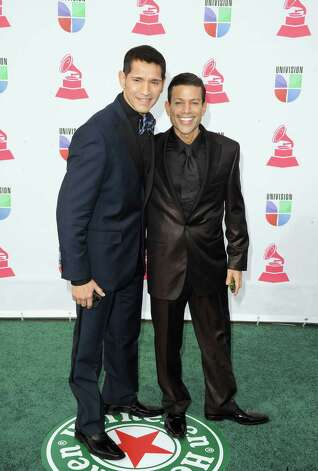Recording artists Luis Perez (L) and Joshua Estrin arrive at the 13th annual Latin GRAMMY Awards held at the Mandalay Bay Events Center on November 15, 2012 in Las Vegas, Nevada. Photo: Jason Merritt, Getty Images / 2012 Getty Images