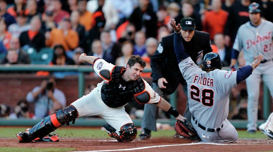 Giants' catcher Buster Posey makes the play at home against Tigers' first baseman Prince Fielder  in the 2nd inning during game 2 of the World Series at AT&T Park on Thursday, Oct. 25, 2012 in San Francisco, Calif. Photo: Michael Macor, The Chronicle / ONLINE_YES