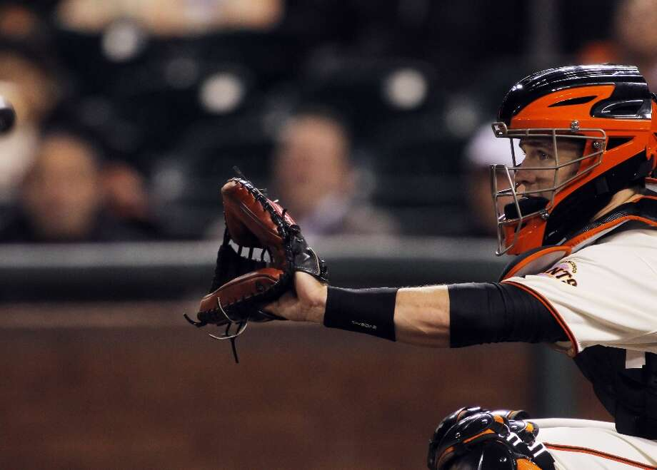 Buster Posey waits for the pitch as he catches for the Giants. The San Francisco Giants played the Arizona Diamondbacks at AT&T Park in San Francisco, Calif., on Wednesday, September 26, 2012, defeating the Diamondbacks 6-0 Photo: Carlos Gonzalez, The Chronicle / ONLINE_YES
