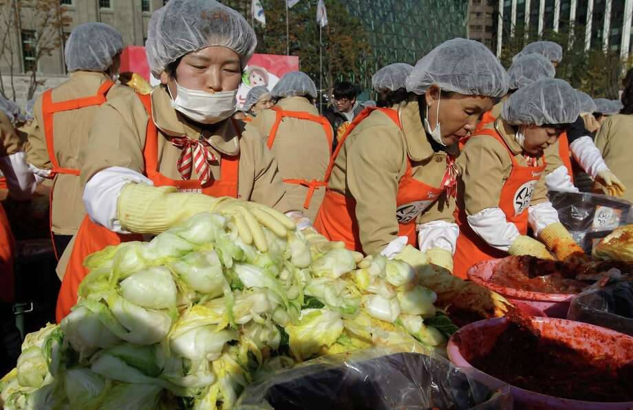 SEOUL, SOUTH KOREA - NOVEMBER 15:  More than two thousand housewives make Kimchi for donation to the poor in preparation for winter in front of City Hall on November 15, 2012 in Seoul, South Korea. Kimchi is a traditional Korean dish of fermented vegetables usually mixed with chili and eaten with rice or served as a side dish to a main meal. Photo: Chung Sung-Jun, Getty Images / 2012 Getty Images