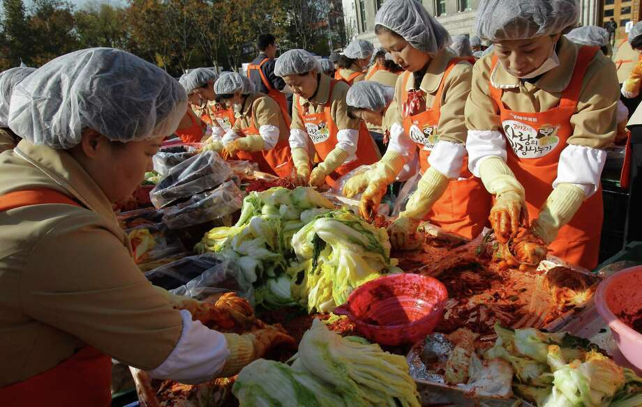 SEOUL, SOUTH KOREA - NOVEMBER 15:  More than two thousands of housewives make Kimchi for donation to the poor in preparation for winter in front of City Hall on November 15, 2012 in Seoul, South Korea. Kimchi is a traditional Korean dish of fermented vegetables usually mixed with chili and eaten with rice or served as a side dish to a main meal. Photo: Chung Sung-Jun, Getty Images / 2012 Getty Images