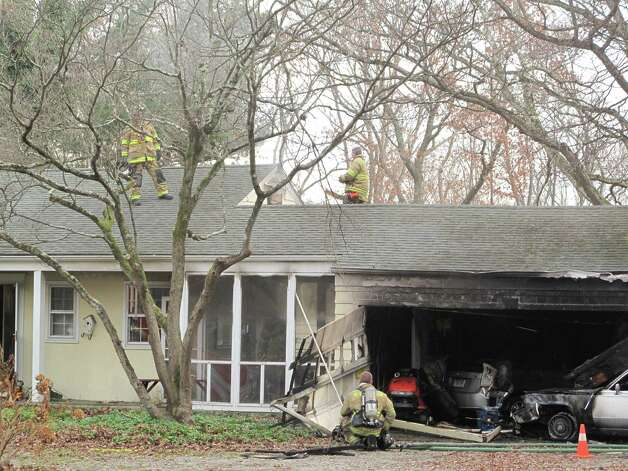A car crashed into a home on White Birch Road in New Canaan, Ct. The accelerator was reportedly stuck and the driver jumped out of the car before impact. Nov. 15, 2012. Photo: Tyler Woods