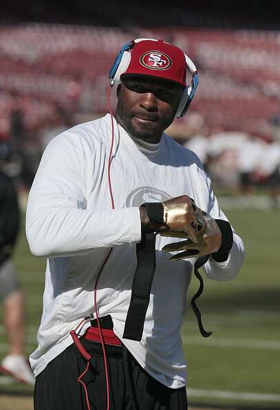 In this Nov. 11, 2012, photo, San Francisco 49ers running back Brandon Jacobs warms up before an NFL
