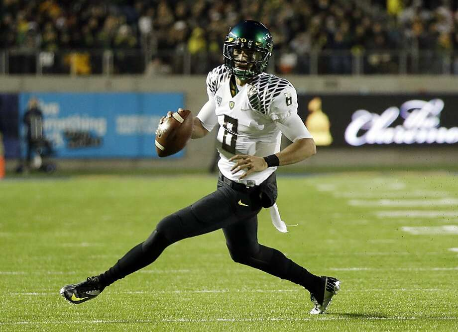 Oregon's Marcus Mariota, who's no ordinary redshirt freshman, threw for six TDs against Cal. Photo: Marcio Jose Sanchez, Associated Press