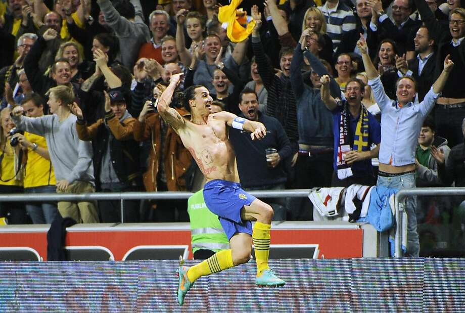 Sweden's Zlatan Ibrahimovic celebrates his wondrous fourth goal against England in this week's exhibition. Photo: Fredrik Sandberg, Associated Press