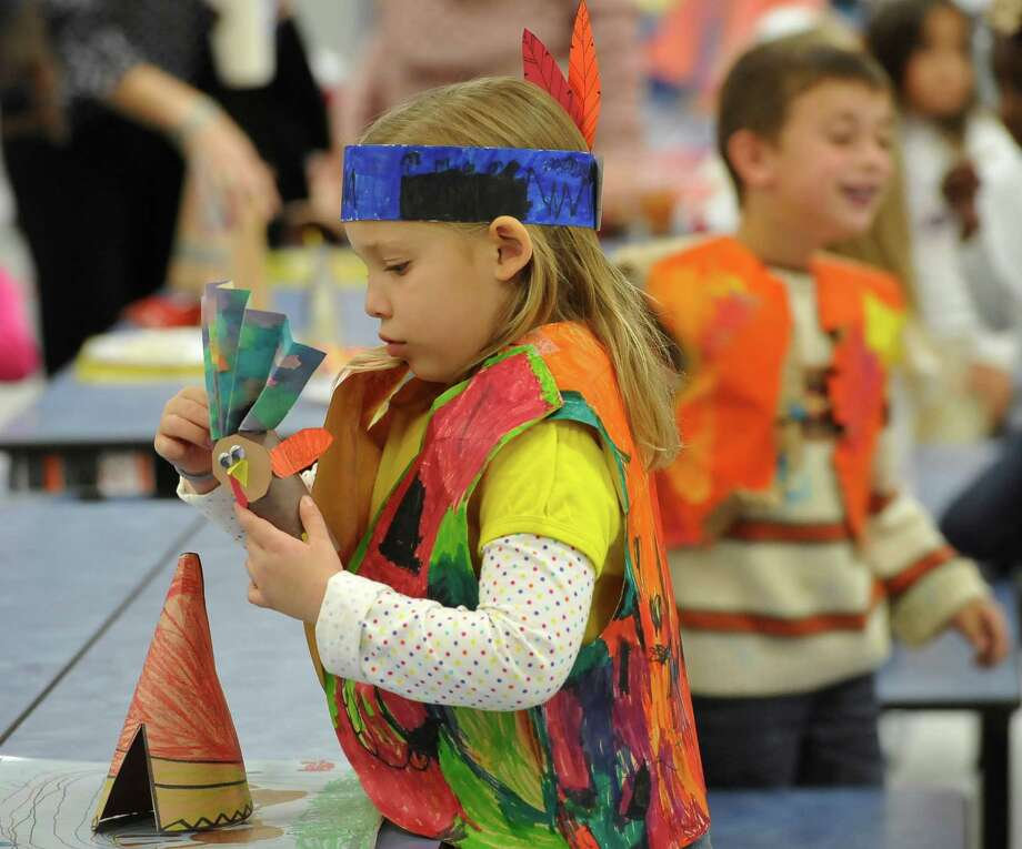Thursday was the Feast Day for approximately 115 kindergarten students at Sallie Curtis Elementary School. After learning about Thanksgiving during the week, they got to dress up as Indians, complete with headbands, or Pilgrims, and shared a parent-supplied Thanksgiving Day type feast in the school's new cafeteria.  The food was not exactly like what was eaten at the original Thanksgiving feast, but the kids did not seem to mind. Dave Ryan/The Enterprise