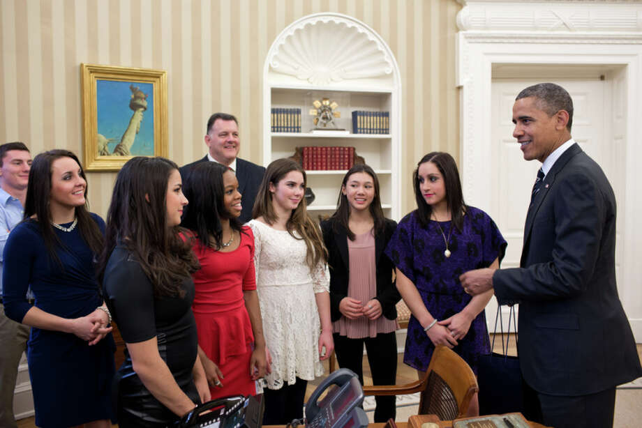 President Obama met with members of the 2012 U.S. Olympic gymnastics teams in the Oval Office on Thursday. Pictured, from left, are: Steven Gluckstein, former Newton resident Savannah Vinsant, Aly Raisman, Gabby Douglas, Steve Penny, USA Gymnastics President, McKayla Maroney, Kyla Ross, and Jordyn Wieber.  Pete Souza/Official White House Photo