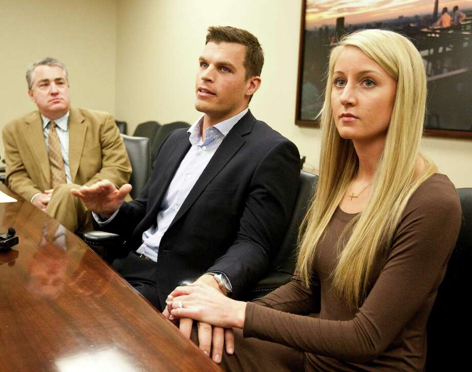 Former Texans punter Brett Hartmann, flanked by his fiancee Lizzy Burkald and attorney Eugene Egdor, says he remembers his injury vividly. Photo: Nick De La Torre, Staff / © 2012  Houston Chronicle