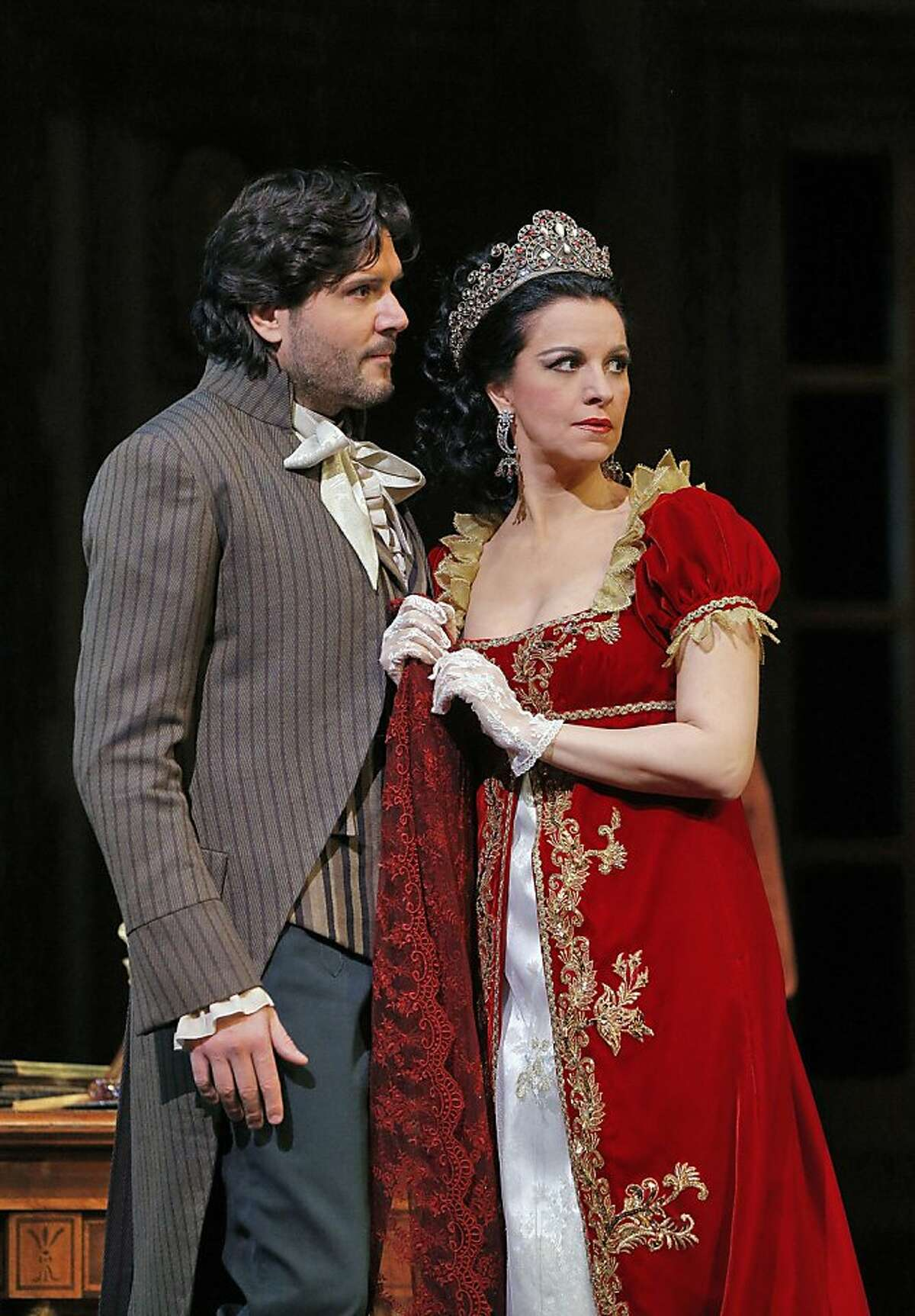 Tosca Act II Massimo Giordano (Cavaradossi) and Angela Gheorghiu (Tosca).