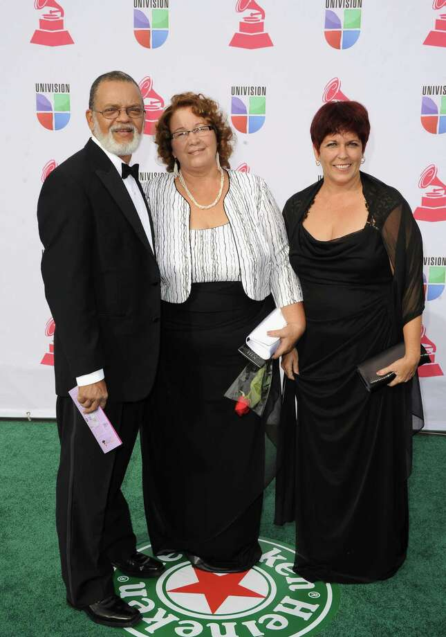 (L-R) Musicians Mario Manuel Etutierrez Dias and Ernestina Trimino Velaso of Quinteto Criollo and guest arrive at the 13th annual Latin GRAMMY Awards held at the Mandalay Bay Events Center on November 15, 2012 in Las Vegas, Nevada. Photo: Jason Merritt, Getty Images / 2012 Getty Images