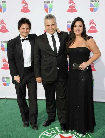 (L-R) Musicians Daniel Musy and Andre Dias and singer Viviane Ciminelli arrive at the 13th annual Latin GRAMMY Awards held at the Mandalay Bay Events Center on November 15, 2012 in Las Vegas, Nevada. Photo: Jason Merritt, Getty Images / 2012 Getty Images