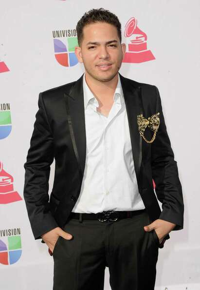 Producer Milton Jhoan Restituyo Alcover of A&X arrives at the 13th annual Latin GRAMMY Awards held