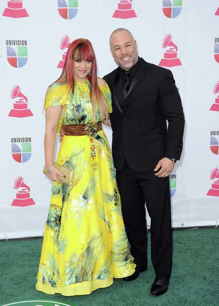 Producer and composer Ray Casillas (R) and Karen Casillas arrive at the 13th annual Latin GRAMMY A