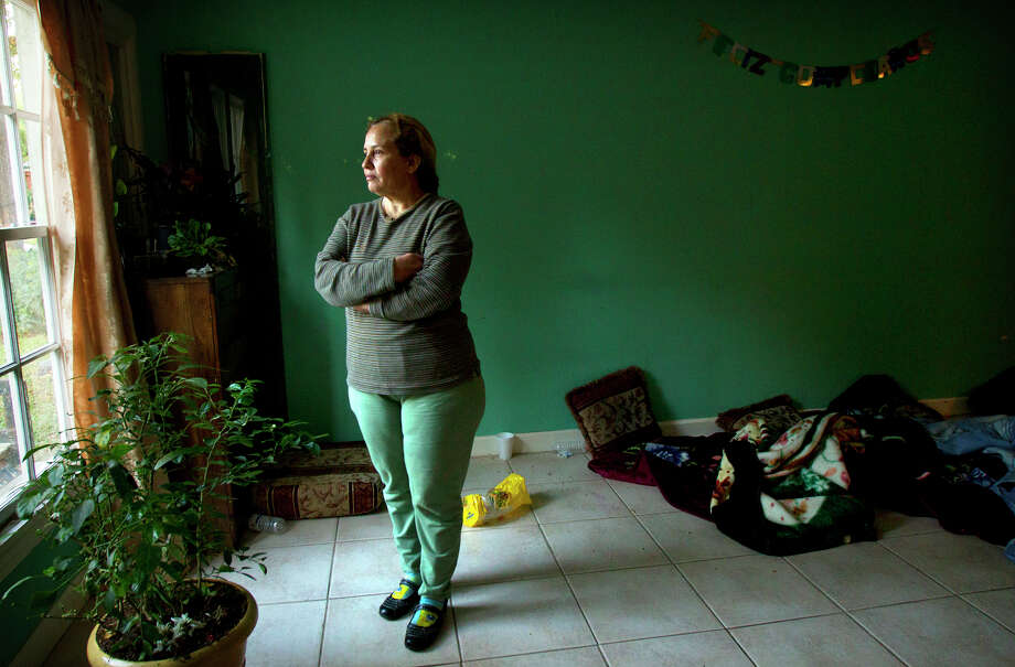Elena Soto says she and her husband, Humberto, were awakened by police shortly after midnight Thursday. Officers questioned them after a van full of people parked near the home and some ran into her backyard. Photo: Cody Duty, Staff / © 2012 Houston Chronicle