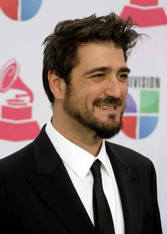 Spanish singer-songwriter Antonio Orozco arrives for the 13th Annual Latin Grammy Awards on November 15, 2012 in Las Vegas, Nevada.    AFP PHOTO/John GURZINSKIJOHN GURZINSKI/AFP/Getty Images Photo: JOHN GURZINSKI, Getty Images / AFP