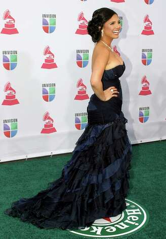 Karen Hoyos arrives for the 13th Annual Latin Grammy Awards on November 15, 2012 in Las Vegas, Nevada.    AFP PHOTO/John GURZINSKIJOHN GURZINSKI/AFP/Getty Images Photo: JOHN GURZINSKI, Getty Images / AFP