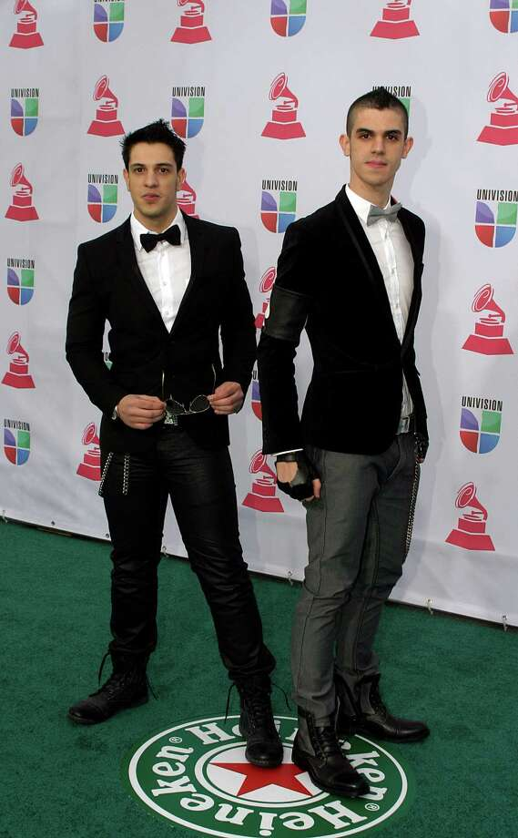 Music group Black Rose Drive arrives for the 13th Annual Latin Grammy Awards on November 15, 2012 in Las Vegas, Nevada.    AFP PHOTO/John GURZINSKIJOHN GURZINSKI/AFP/Getty Images Photo: JOHN GURZINSKI, Getty Images / AFP
