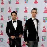 Music group Black Rose Drive arrives for the 13th Annual Latin Grammy Awards on November 15, 2012 in Las Vegas, Nevada.    AFP PHOTO/John GURZINSKIJOHN GURZINSKI/AFP/Getty Images