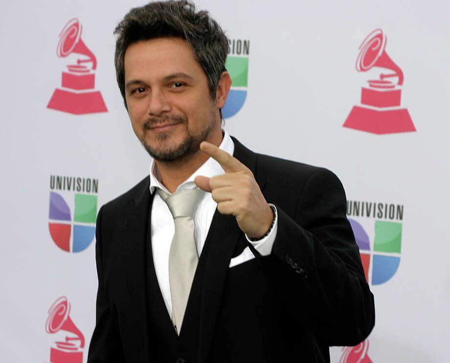 Singer Alejandro Sanz arrives for the 13th Annual Latin Grammy Awards on November 15, 2012 in Las Vegas, Nevada.    AFP PHOTO/John GURZINSKIJOHN GURZINSKI/AFP/Getty Images Photo: JOHN GURZINSKI, Getty Images / AFP