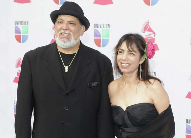Jazz musician Poncho Sanchez (L) and his wife Stella Sanchez arrive for the 13th Annual Latin Grammy Awards on November 15, 2012 in Las Vegas, Nevada.    AFP PHOTO/John GURZINSKIJOHN GURZINSKI/AFP/Getty Images Photo: JOHN GURZINSKI, Getty Images / AFP